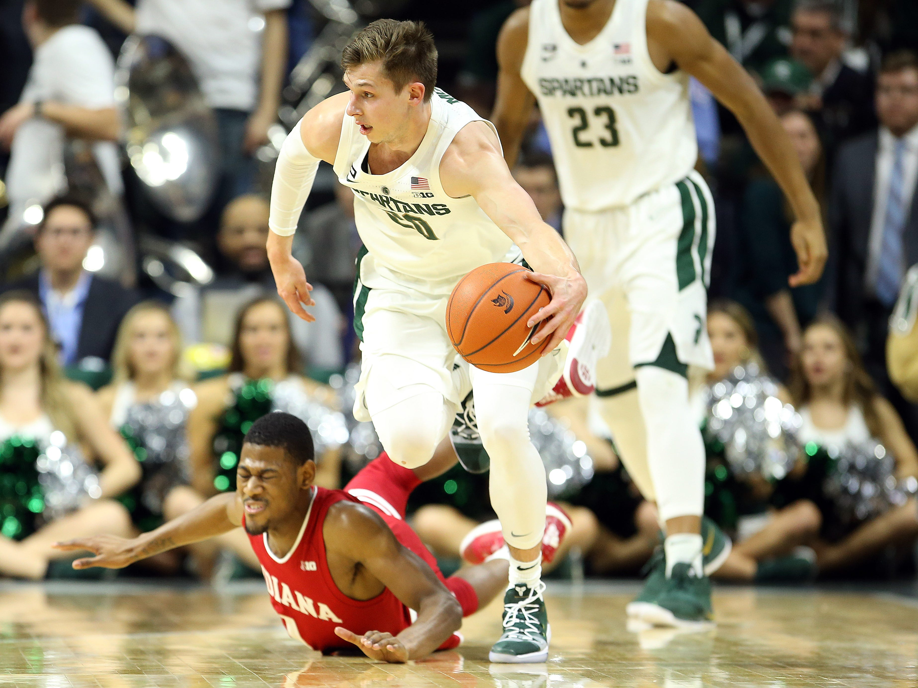 Michigan State guard Matt McQuaid  steals the ball from Indiana guard Aljami Durham during the first half  at the Breslin Center, Feb. 2, 2019.
