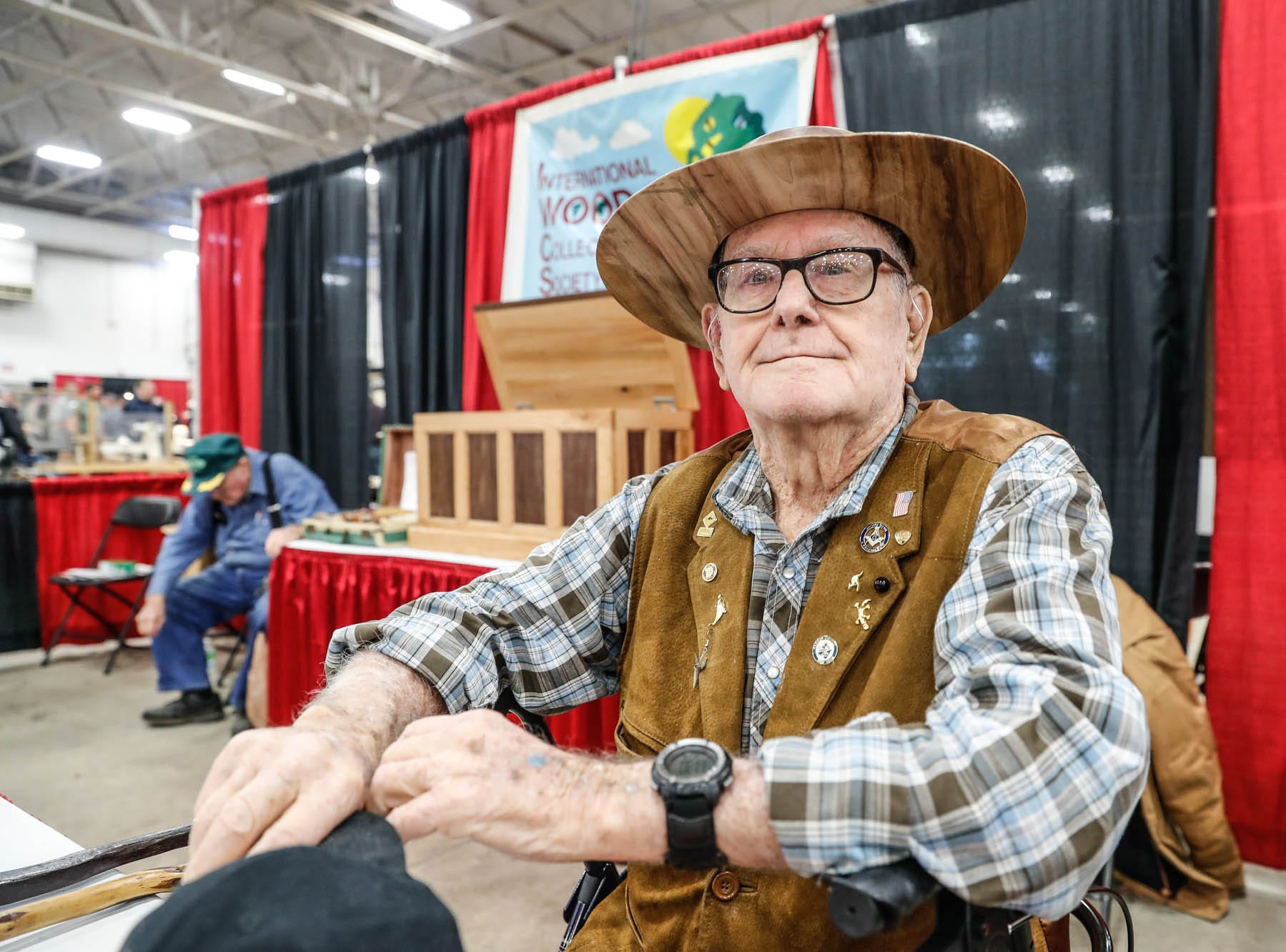 Bill Perkins, age 91, shows off the wooden hat he carved at the International Wood Collectors Society booth during a Wood Working Show at the Indiana State Fairgrounds in Indianapolis on Sunday, Feb. 3, 2019.