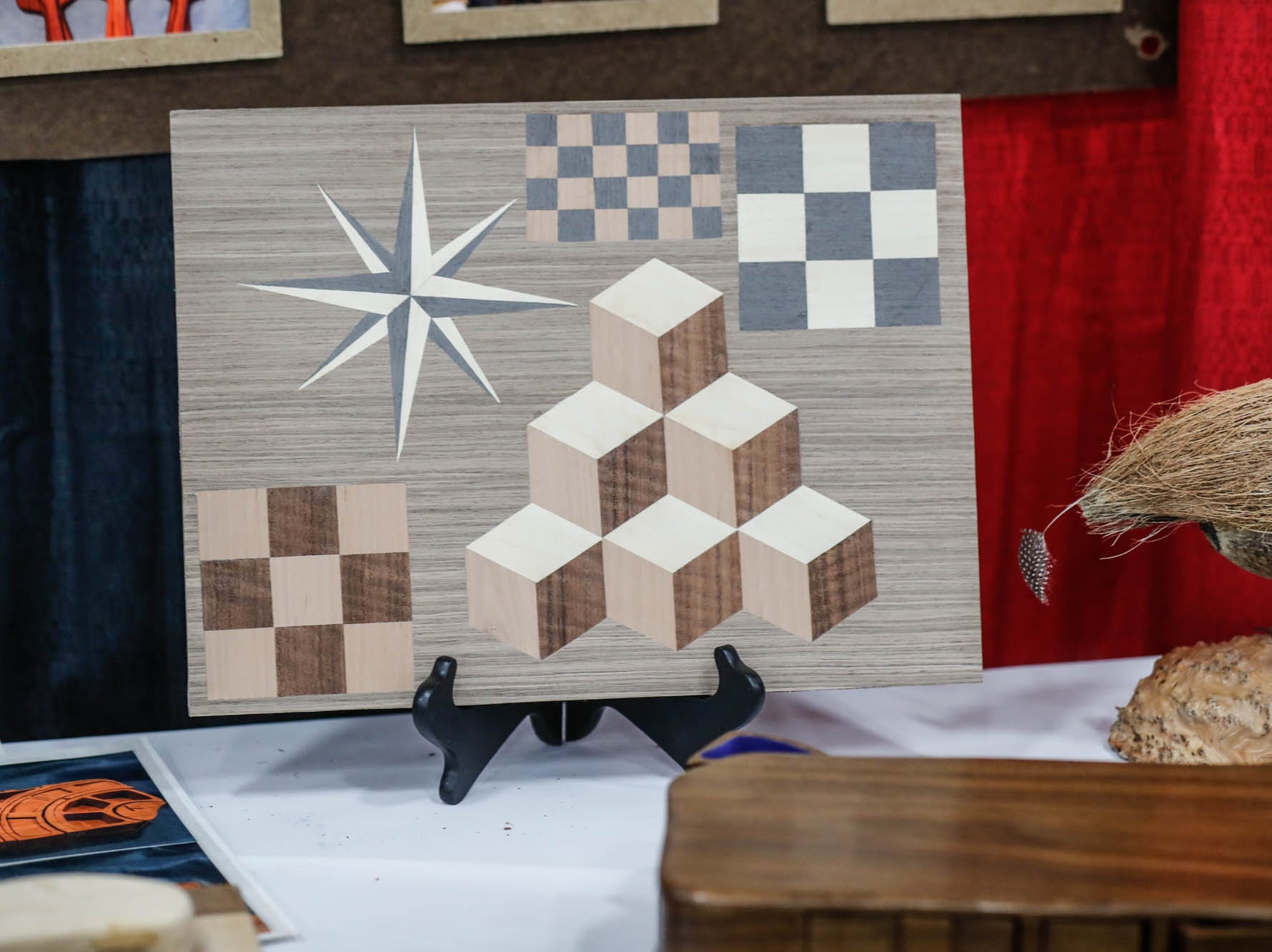 Hand made items are on display in the Women's Woodworking Guild of Indiana booth during a Wood Working Show at the Indiana State Fairgrounds in Indianapolis on Sunday, Feb. 3, 2019.