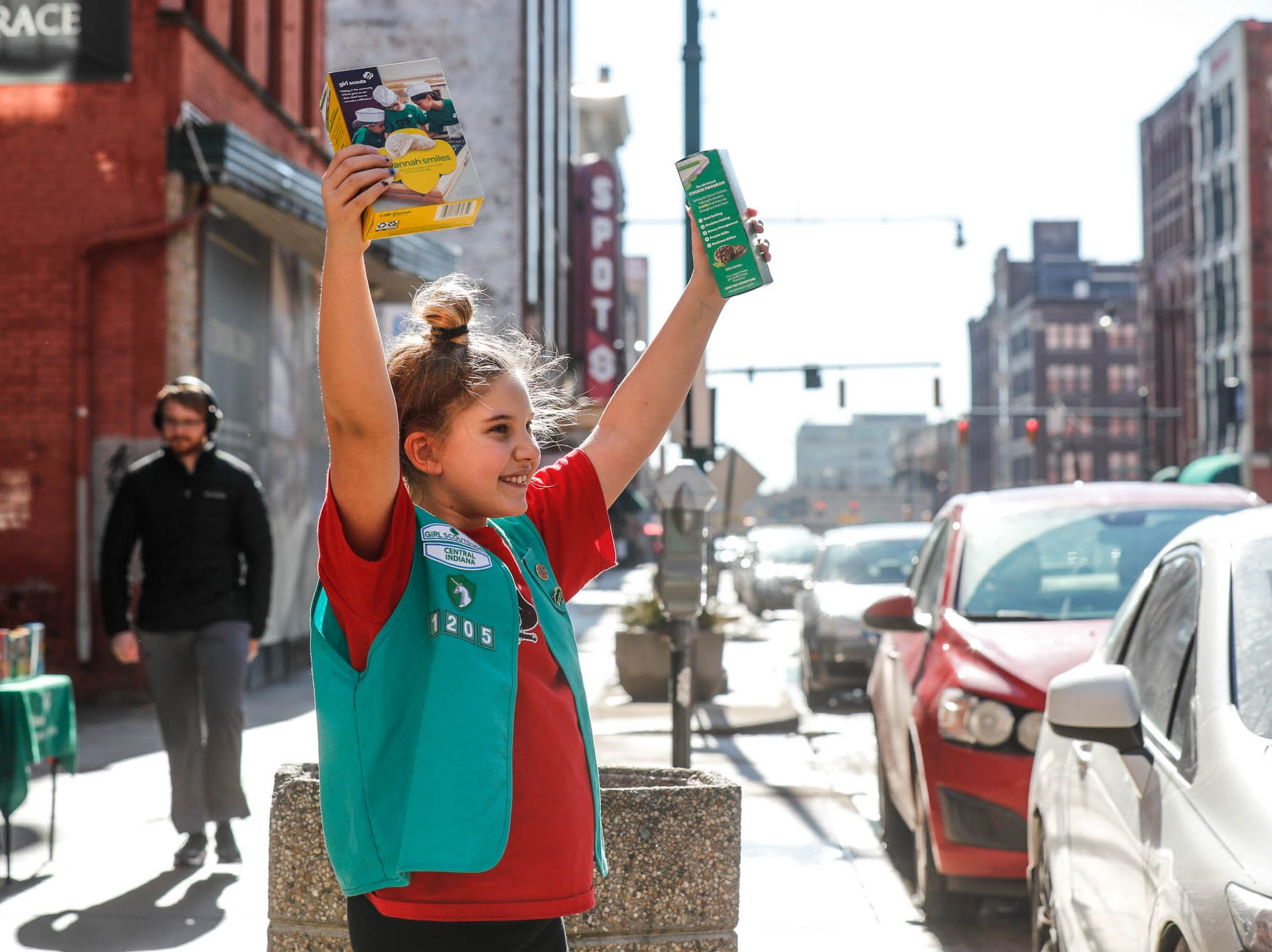Lyndsey Baker, from troop 1205, dances wile selling Girl Scout Cookies along S. Meridian St., on a near sixty-degree afternoon in Indianapolis on Sunday, Feb. 3, 2019.