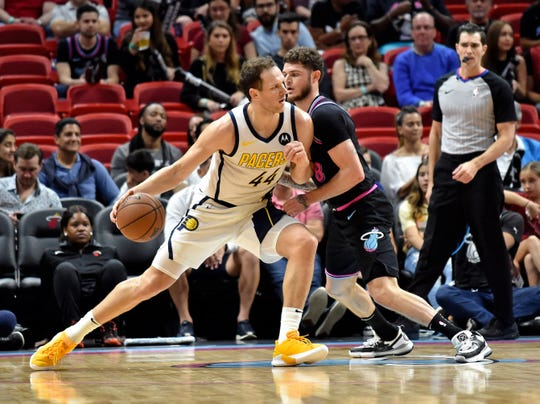 Pacers forward Bojan Bogdanovic (44) is guarded by Miami Heat guard Tyler Johnson (8) during the first half at American Airlines Arena.