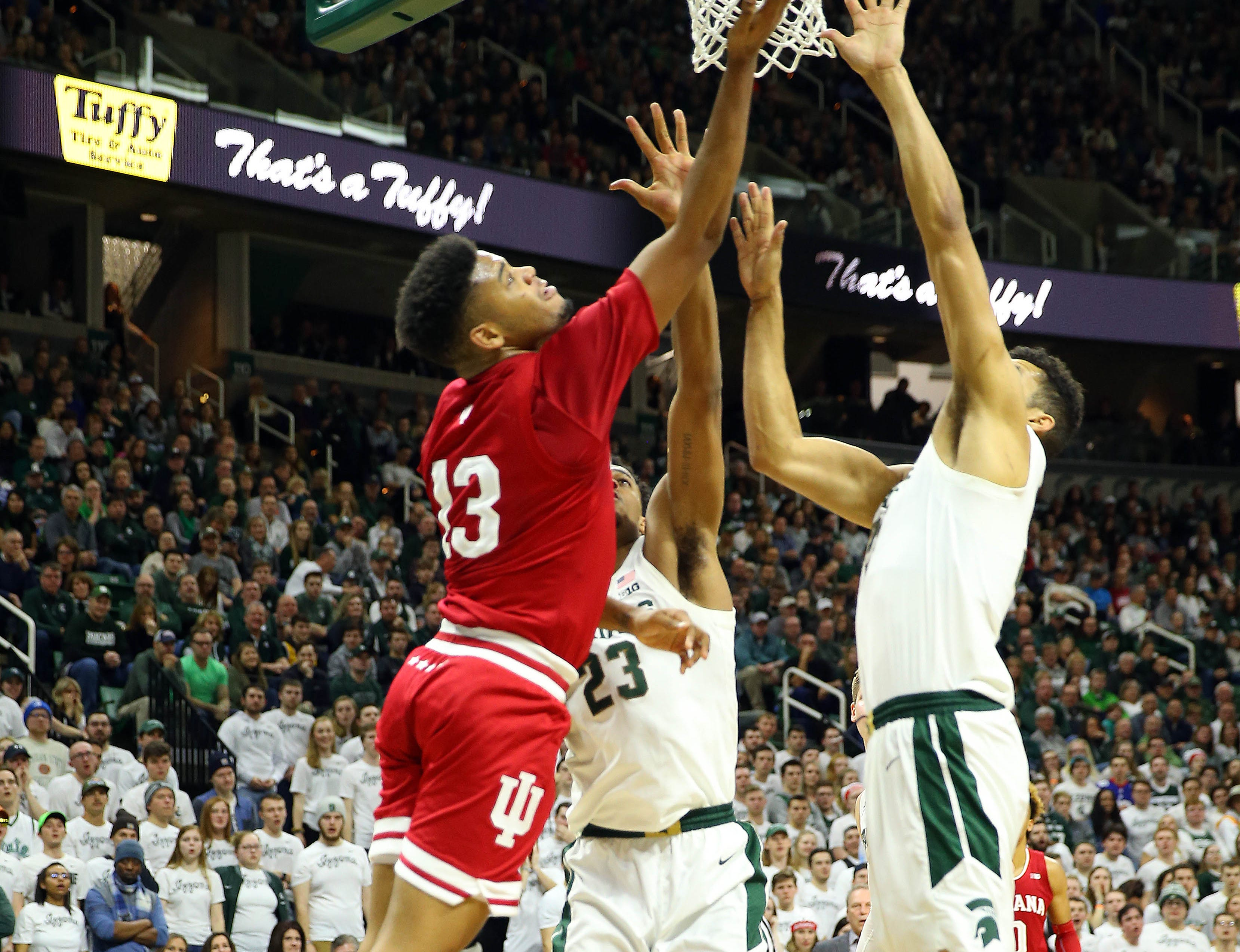 Indiana Hoosiers forward Juwan Morgan has his shot blocked by Michigan State Spartans forward Kenny Goins (25) during the first half  at the Breslin Center.