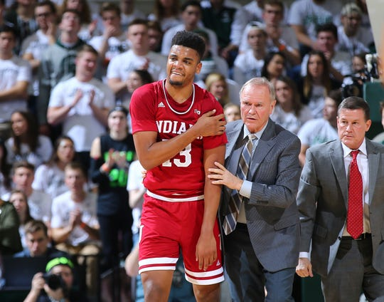 Juwan Morgan #13 of the Indiana Hoosiers is help off the court  in the first half during a game against the  Michigan State Spartan at Breslin Center on February 2, 2019 in East Lansing, Michigan. (Photo by Rey Del Rio/Getty Images)