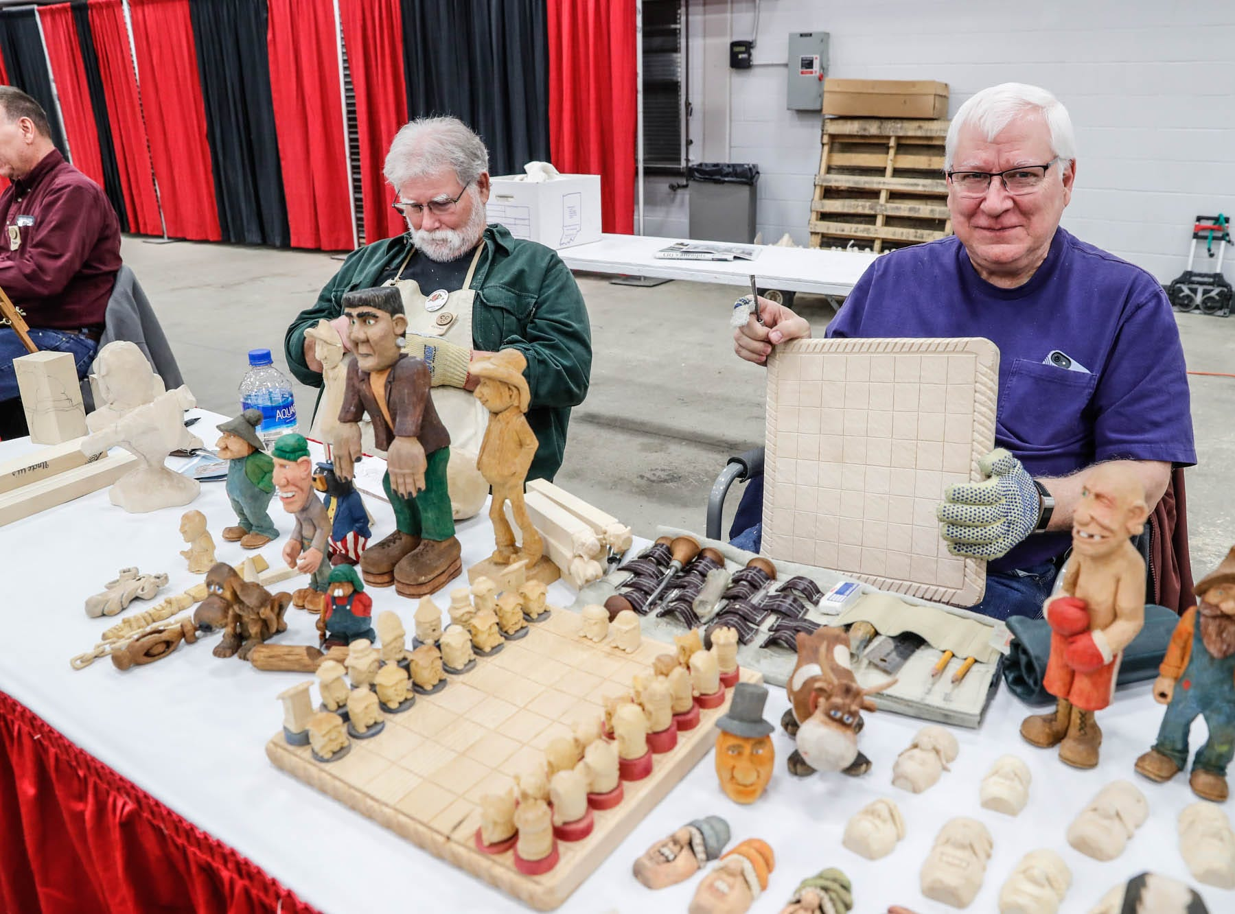 Richard Osborne, left, and Greg May, right, work on projects during a Wood Working Show at the Indiana State Fairgrounds in Indianapolis on Sunday, Feb. 3, 2019.