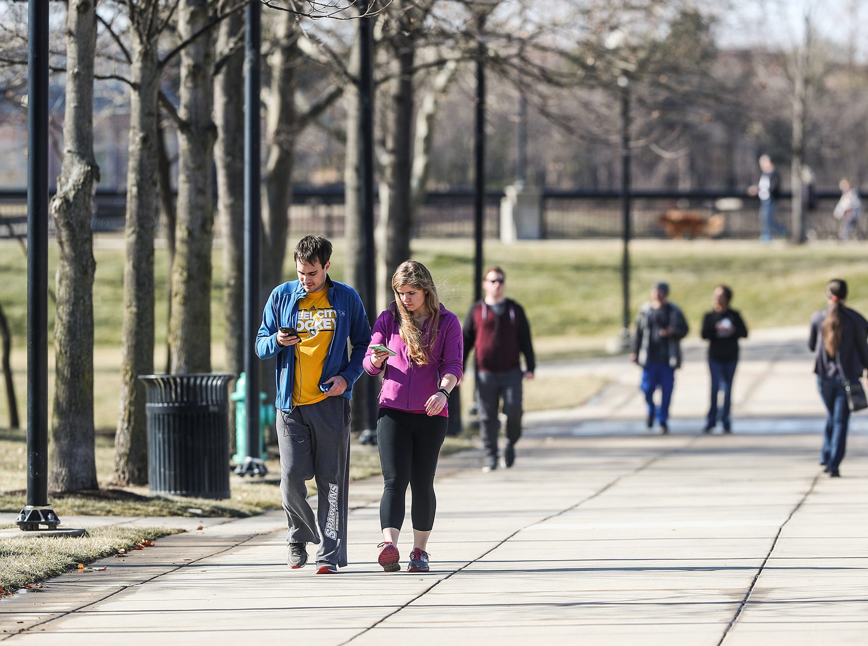 Pedestrians enjoy a 65-degree day at White River State Park in Indianapolis, Sunday, Feb. 3, 2019. The warm weather comes just days after sub-zero temperatures swept over Indiana.