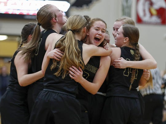 Mt. Vernon Marauders celebrate after they defeated the New Palestine Dragons in their IHSAA girls basketball sectional tournament championship game at Mt Vernon High School in Fortville on Saturday, Feb. 2, 2019. Mt. Vernon defeated New Palestine 35-29.