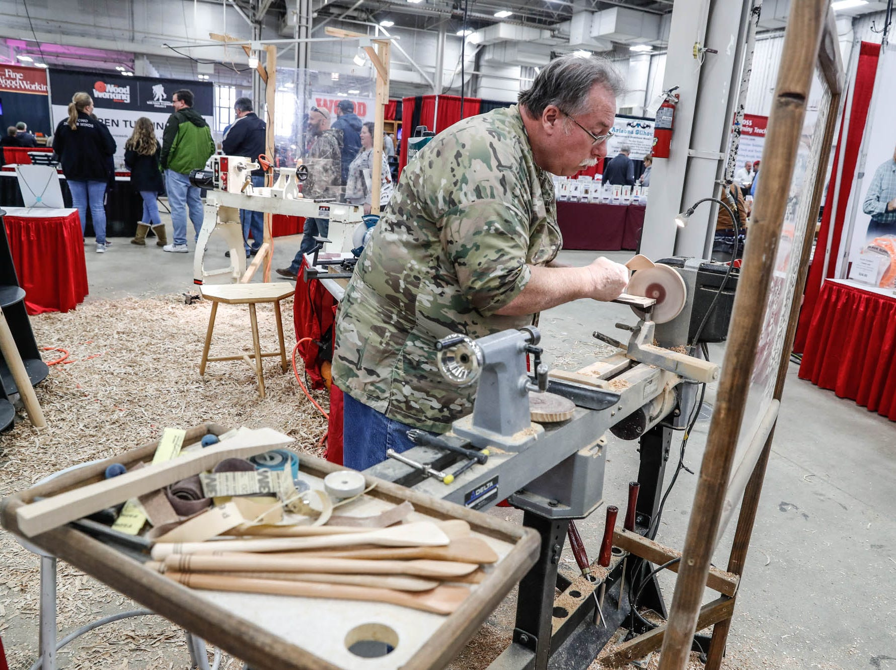 Dahl Perry turns kitchen utensils during a demo at the Wood Working Show at the Indiana State Fairgrounds in Indianapolis on Sunday, Feb. 3, 2019.