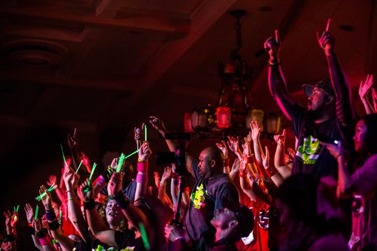 """Morale captains dance on stage during """"Power Hour"""" at the University of Iowa Dance Marathon 25 on Saturday, Feb. 2, 2019, at the Iowa Memorial Union in Iowa City, Iowa."""