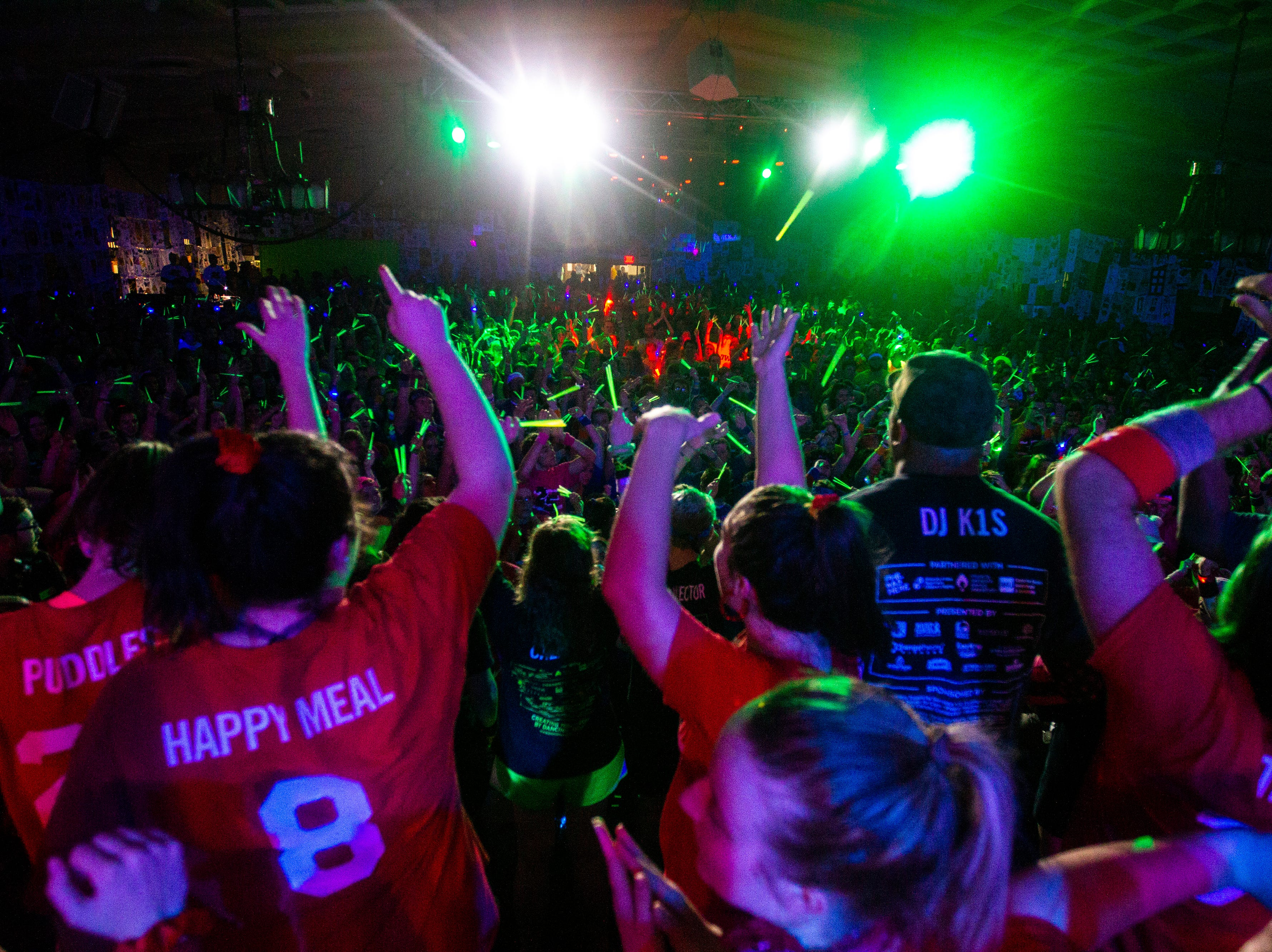 "Morale captains dance on stage during ""Power Hour"" at the University of Iowa Dance Marathon 25 on Saturday, Feb. 2, 2019, at the Iowa Memorial Union in Iowa City, Iowa."