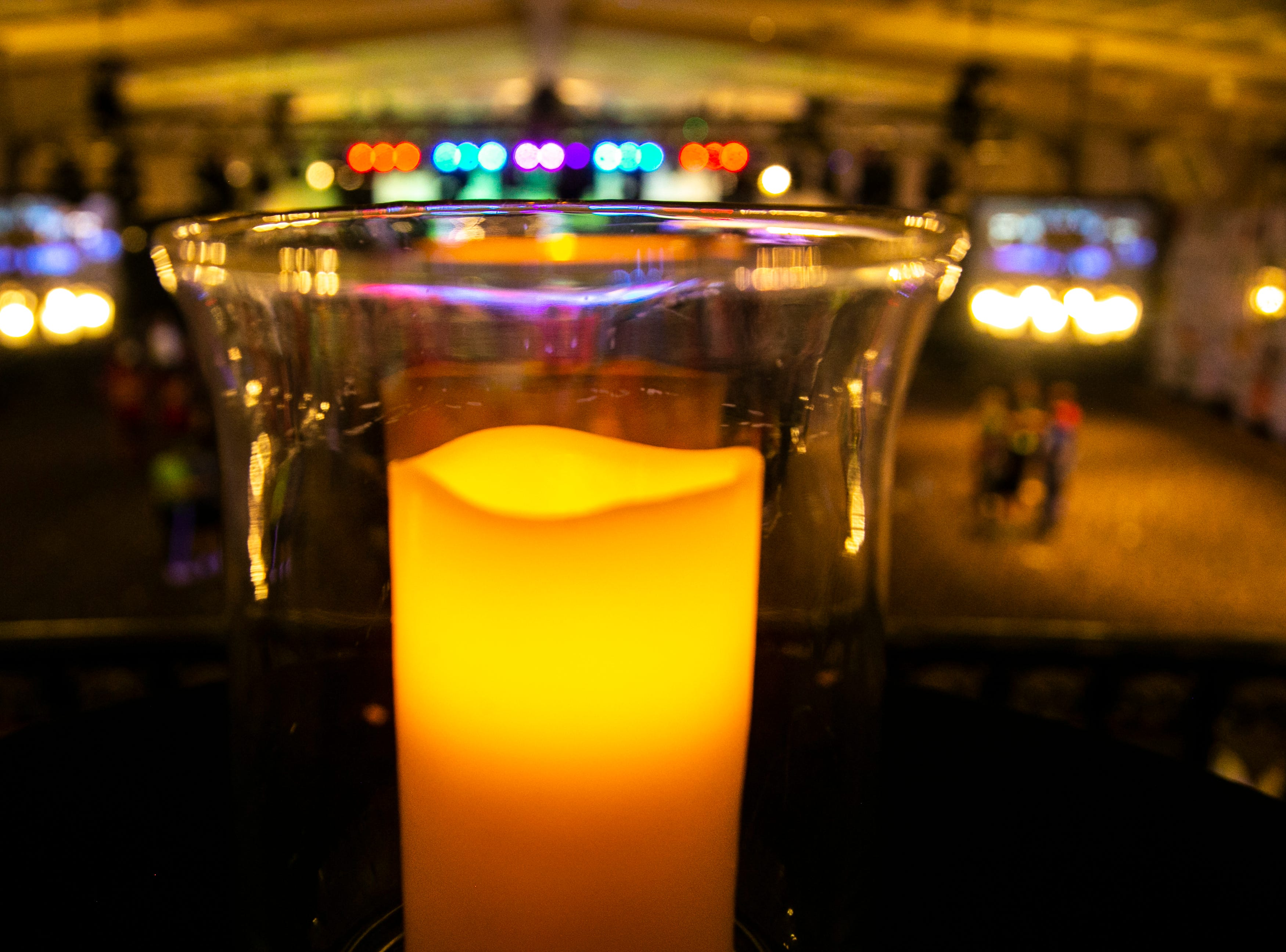 A candle overlooks the ballroom during the University of Iowa Dance Marathon 25 on Saturday, Feb. 2, 2019, at the Iowa Memorial Union in Iowa City, Iowa.