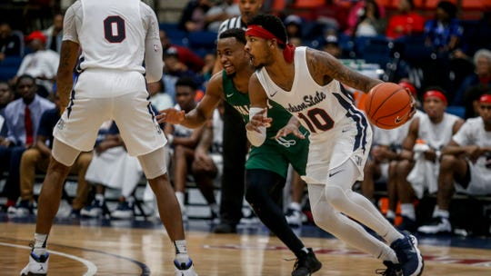 Jontrell Walker dribbles past a defender during Jackson State's game against Mississippi Valley State on Saturday, February 2, 2018 at the Lee E. Williams Athletic and Assembly Center.