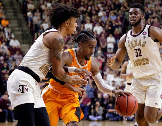 Tennessee guard Jordan Bone, center, drives between Texas A&M guard Brandon Mahan, left, and forward Josh Nebo (32) during the second half of an NCAA college basketball game Saturday, Feb. 2, 2019, in College Station, Texas.