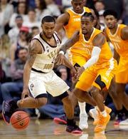 Texas A&M guard TJ Starks, left, recovers the ball in front of Tennessee guard Jordan Bone (0) during the first half of an NCAA college basketball game Saturday, Feb. 2, 2019, in College Station, Texas.