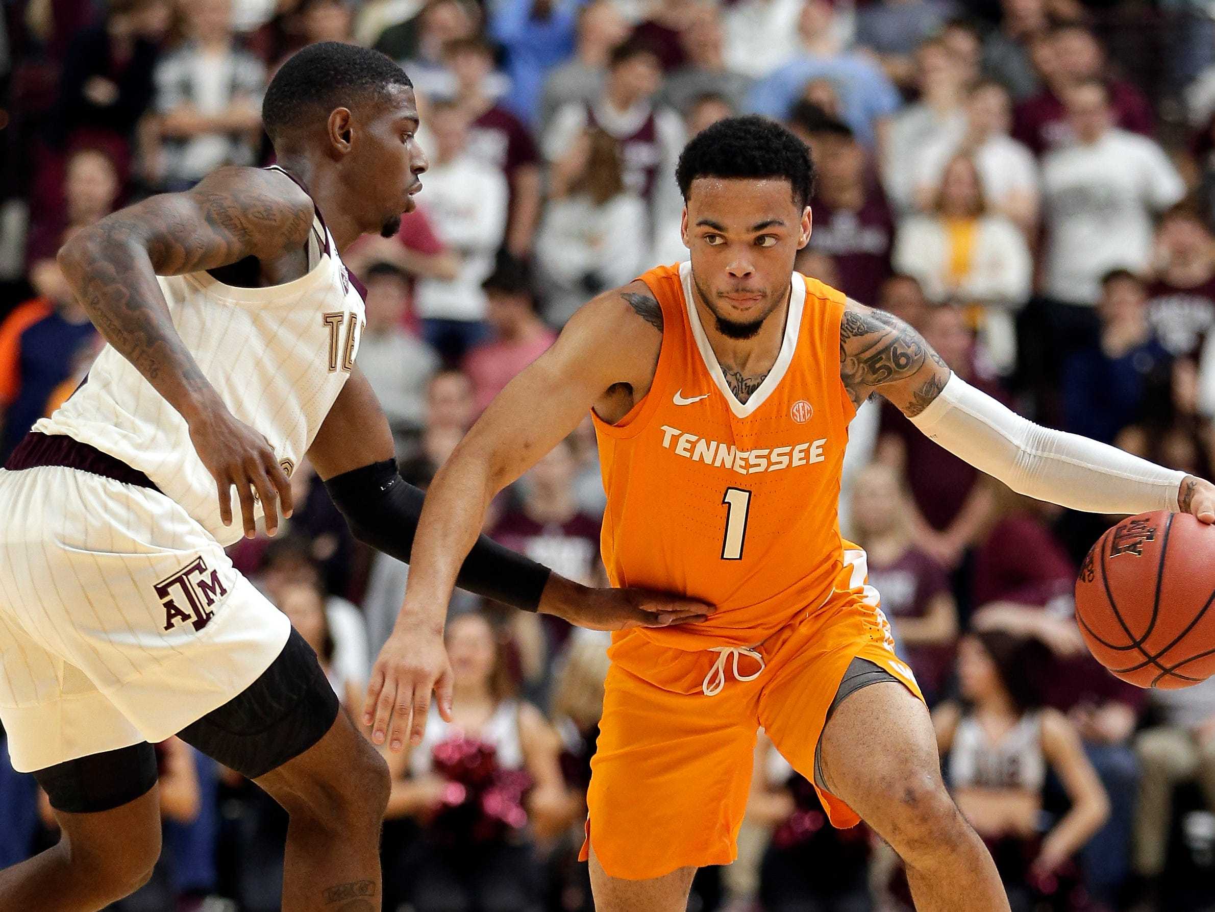 Tennessee guard Lamonte Turner (1) drives around Texas A&M guard Jay Jay Chandler, left, during the second half of an NCAA college basketball game Saturday, Feb. 2, 2019, in College Station, Texas.