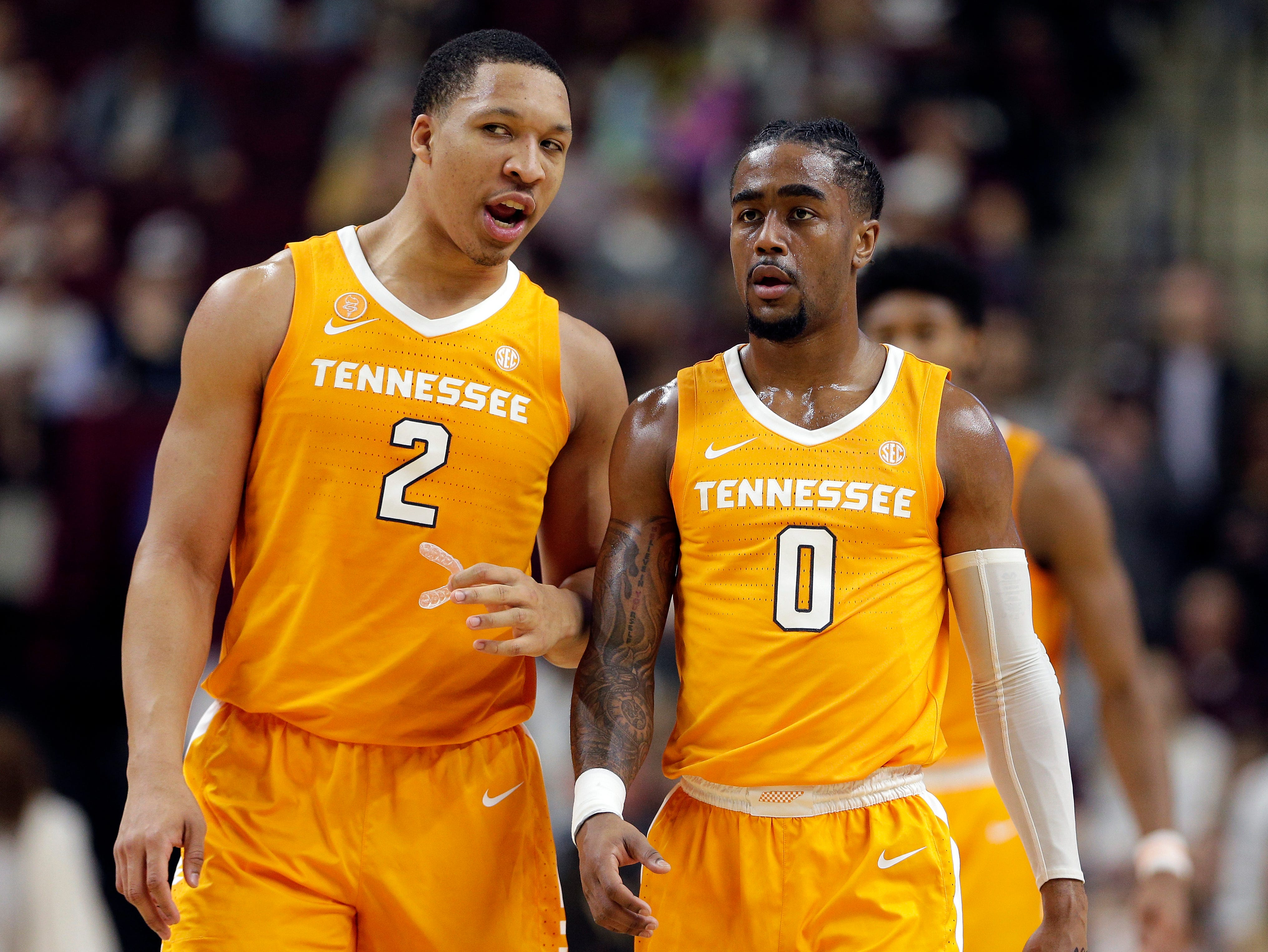 Tennessee forward Grant Williams (2) and guard Jordan Bone (0) talk as they head to the free throw line after a foul during the first half of an NCAA college basketball game against Texas A&M, Saturday, Feb. 2, 2019, in College Station, Texas.