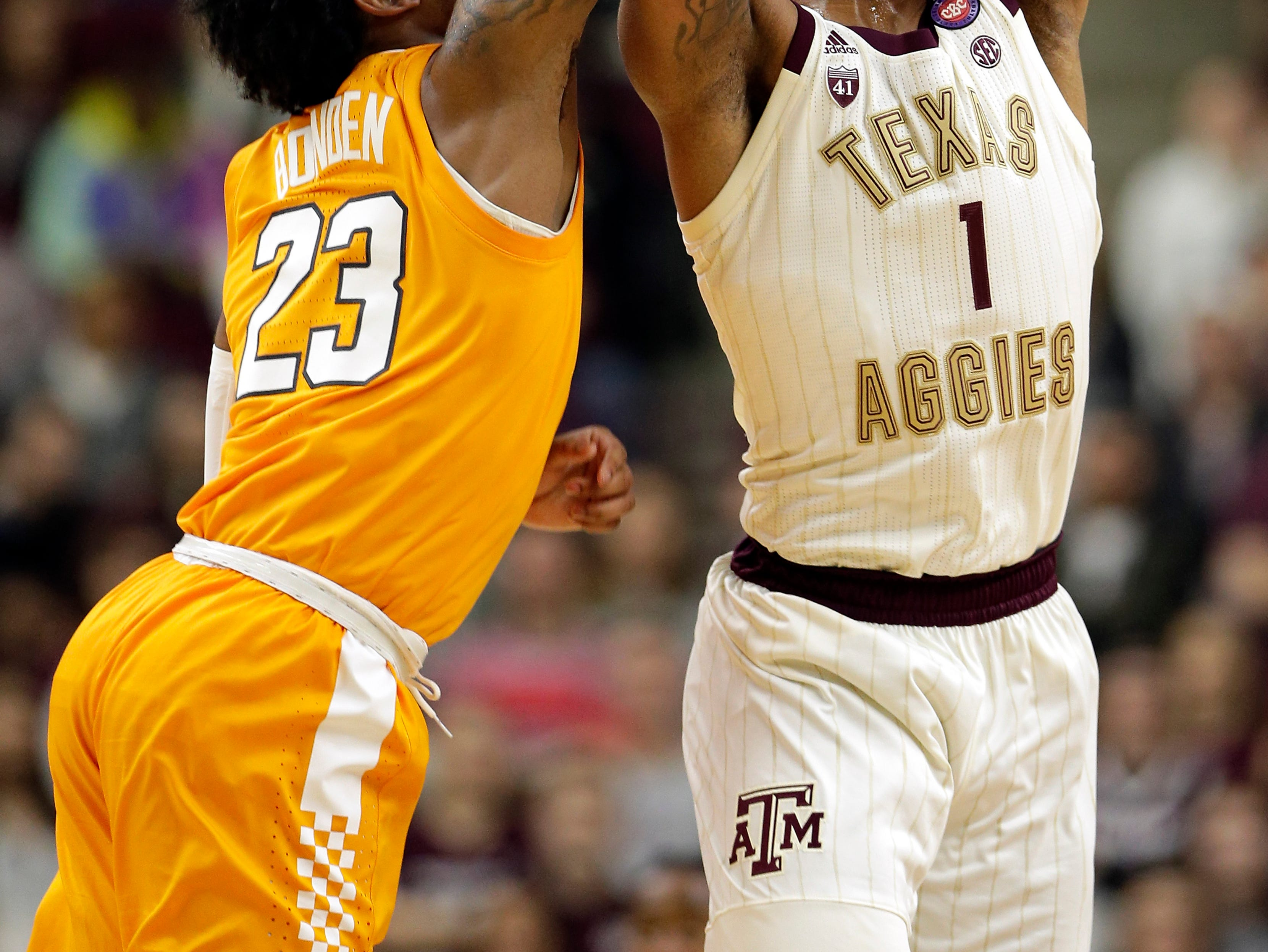 Texas A&M guard Savion Flagg (1) gets control of a midcourt high pass from Tennessee guard Jordan Bowden (23) during the first half of an NCAA college basketball game Saturday, Feb. 2, 2019, in College Station, Texas.