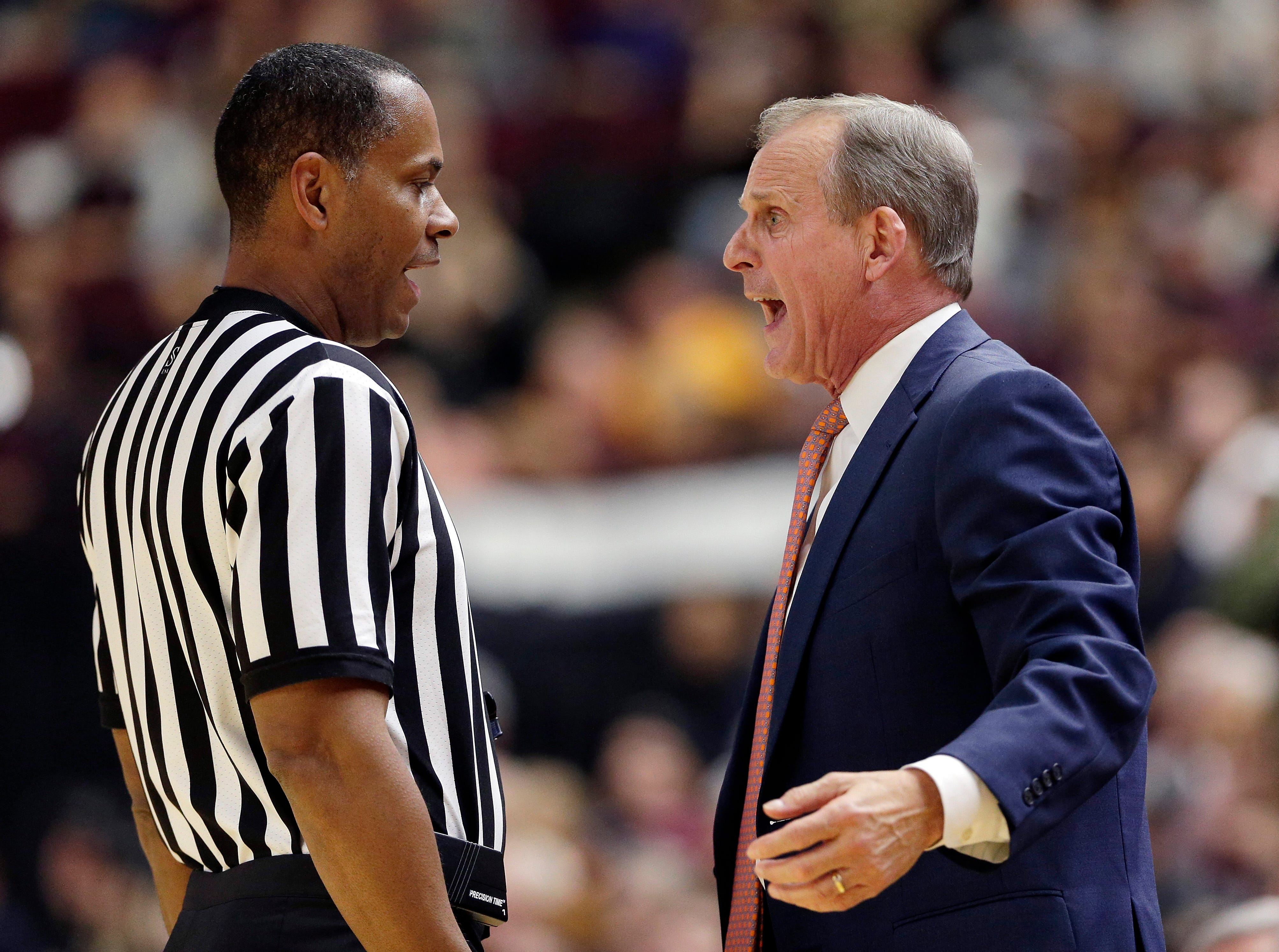 Tennessee head coach Rick Barnes, right, argues a foul call with an official during the second half of an NCAA college basketball game against Texas A&M, Saturday, Feb. 2, 2019, in College Station, Texas.