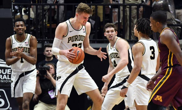 Purdue's Matt Haarms and teammates react to getting on a run during the second half against Minnesota in West Lafayette on Sunday February 3, 2019.