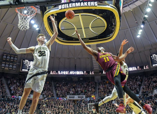 Purdue's Matt Haarms rejects a shot by Minnesota's Isaiah Washington in the first half in West Lafayette on Sunday February 3, 2019.