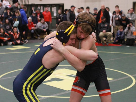 Hartland's Corey Cavanaugh (left) won a 14-5 decision over Brighton's Zach Johnson (right) in the 135-pound final at the KLAA individual wrestling tournament on Saturday, Feb. 2, 2019 at Howell.