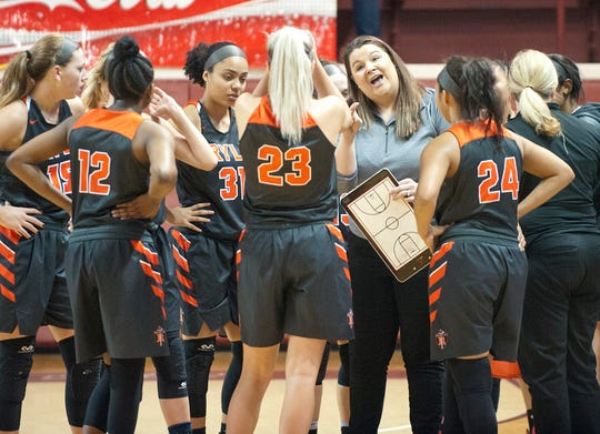 Ryle head basketball coach Katie Haitz instructs her players during a time-out in the championship game of the Girls Louisville Invitational Tournament.03 February 2019