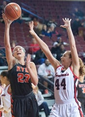 Ryle guard Maddie Scherr drives past Clark County guard Hayley Harrison to score in the championship game of the Girls Louisville Invitational Tournament. Scherr scored a game-high 15 points in her team's 56-45 victory over Clark County.03 February 2019