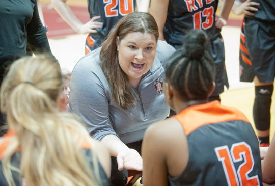 During a time-out, Ryle head basketball coach Katie Haitz tells Ryle forward Austin Johnson to box out  in the championship game of the Girls Louisville Invitational Tournament.03 February 2019