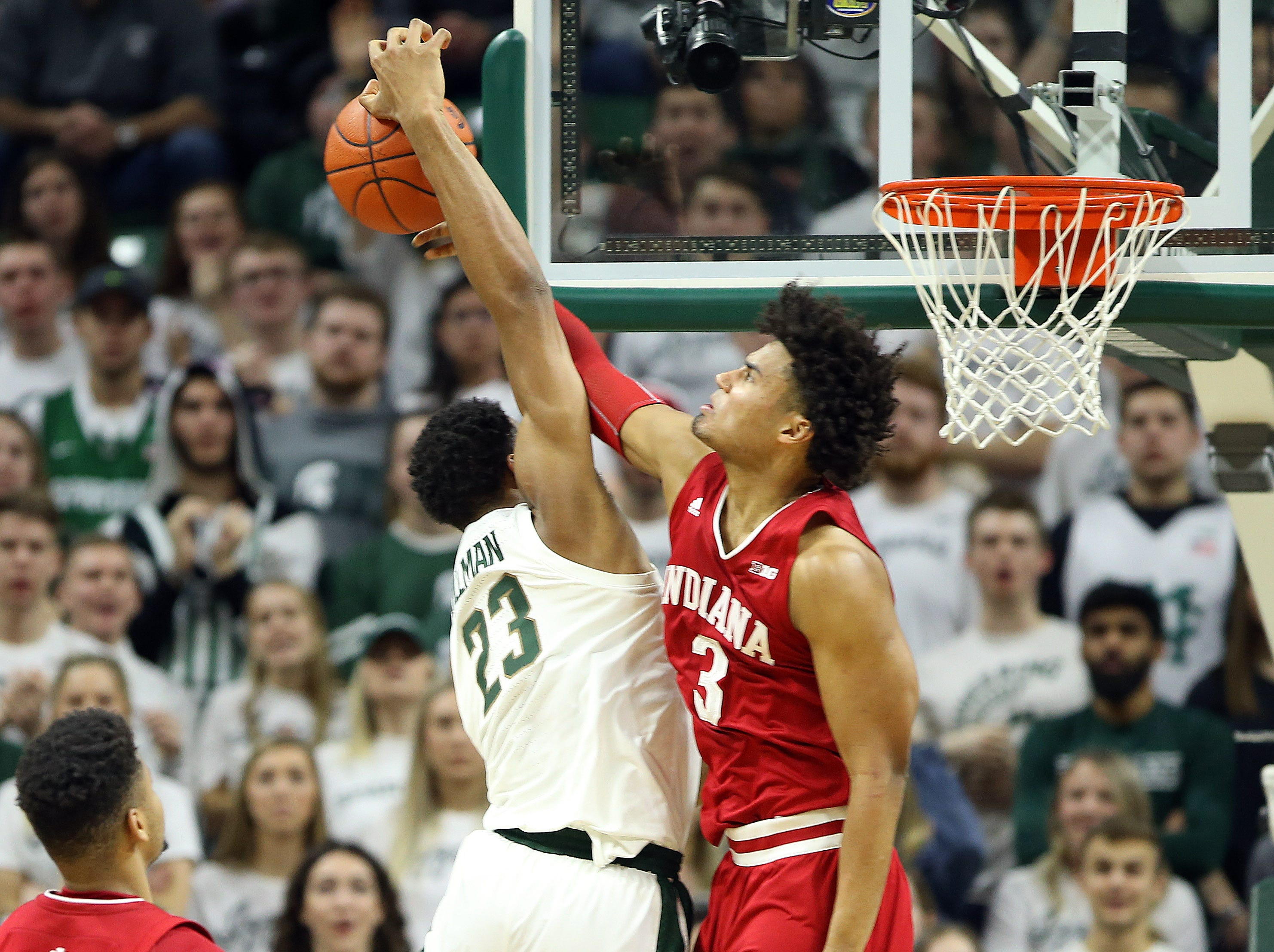 Feb 2, 2019; East Lansing, MI, USA; Michigan State Spartans forward Xavier Tillman (23) has his shot blocked by Indiana Hoosiers forward Justin Smith (3) during the first half at the Breslin Center. Mandatory Credit: Mike Carter-USA TODAY Sports