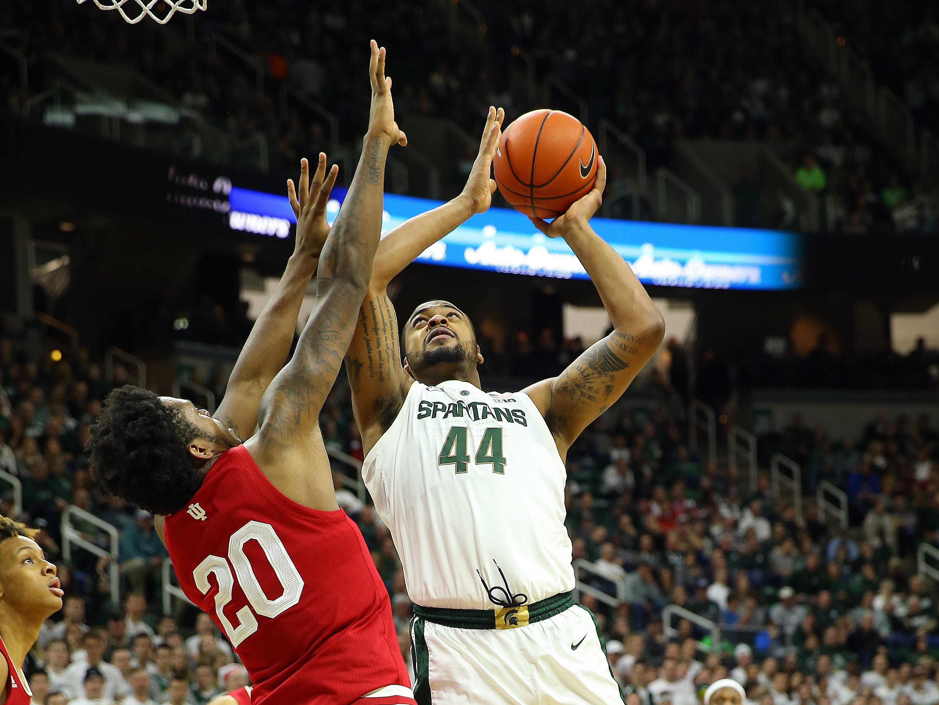 Feb 2, 2019; East Lansing, MI, USA; Michigan State Spartans forward Nick Ward (44) is defended by Indiana Hoosiers forward De'Ron Davis (20) during the first half of a game at the Breslin Center. Mandatory Credit: Mike Carter-USA TODAY Sports