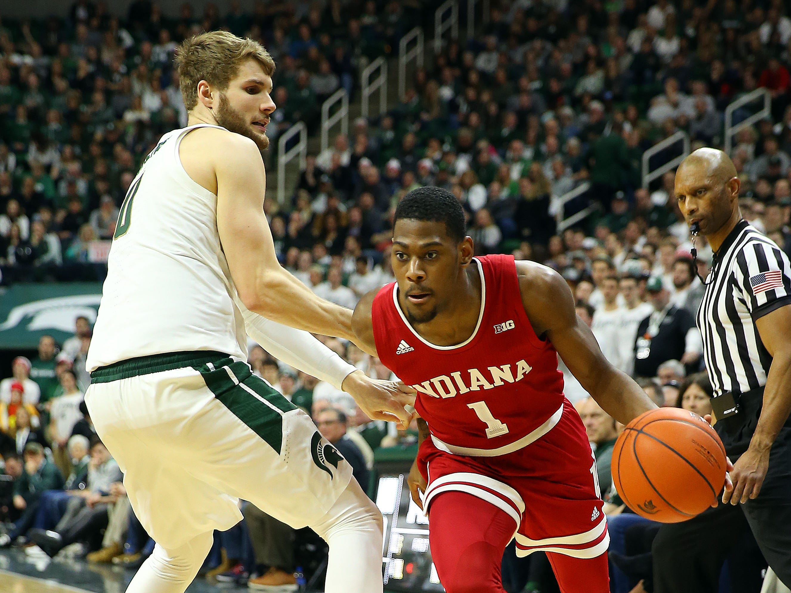 Feb 2, 2019; East Lansing, MI, USA; Indiana Hoosiers guard Aljami Durham (1) moves to the basket against Michigan State Spartans forward Kyle Ahrens (0) during the first half  at the Breslin Center. Mandatory Credit: Mike Carter-USA TODAY Sports