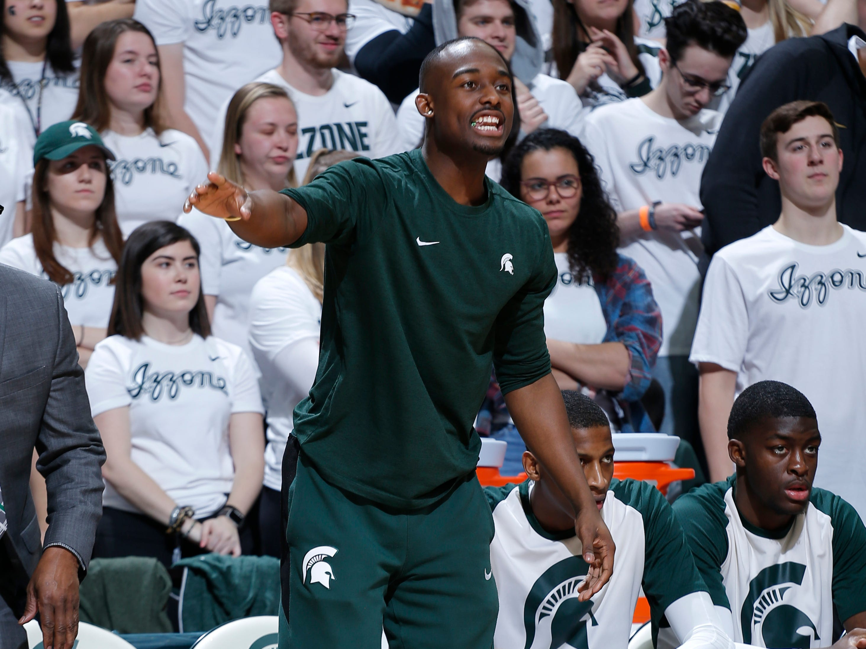 Injured Michigan State junior Joshua Langford shouts instructions to teammates during the Spartans' loss to Indiana on Saturday night. It was the first game since Langford was ruled out for the season with an ankle injury.