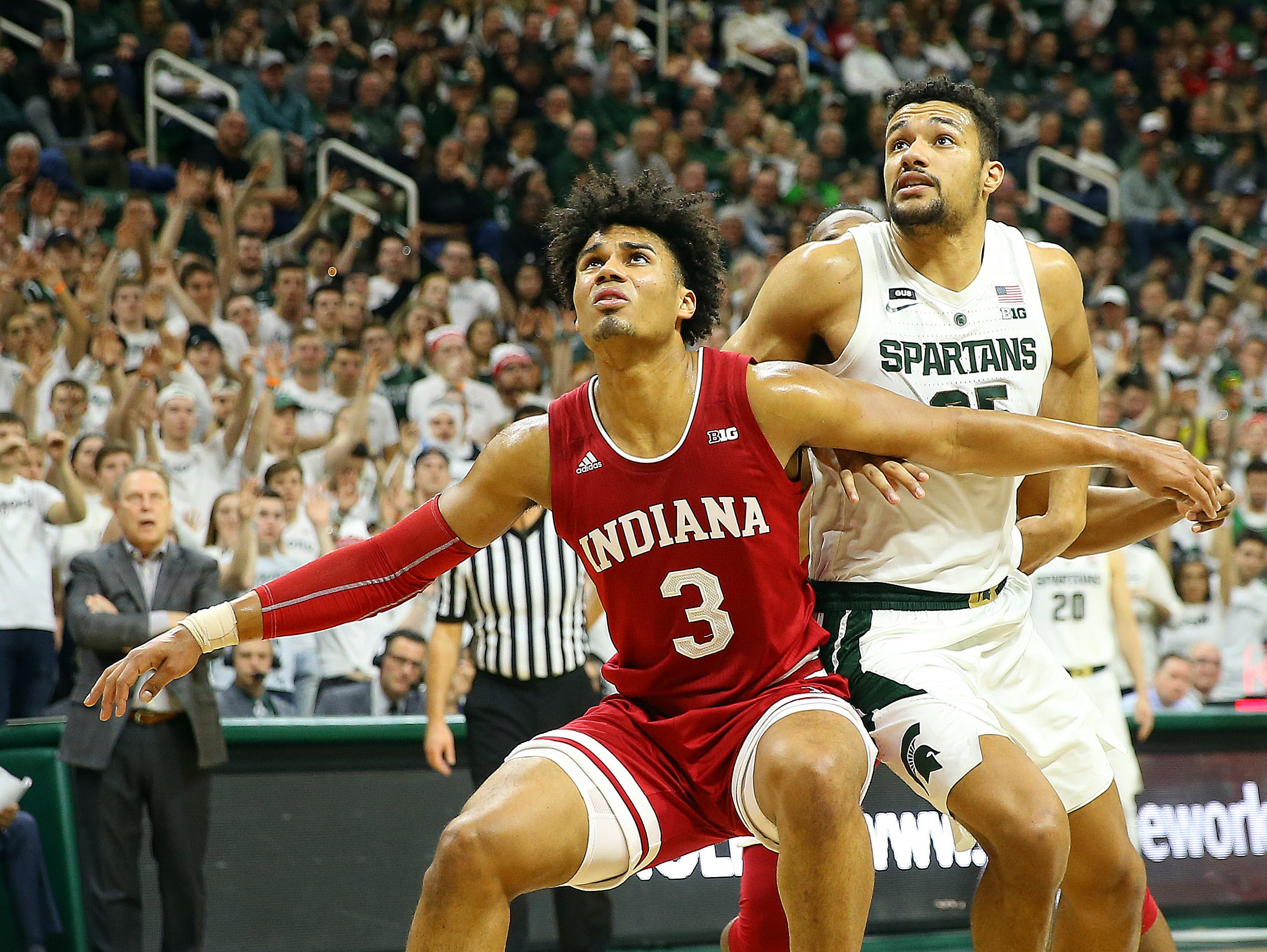 Feb 2, 2019; East Lansing, MI, USA; Indiana Hoosiers forward Justin Smith (3) and Michigan State Spartans forward Kenny Goins (25) fight for position during the second half of a game at the Breslin Center. Mandatory Credit: Mike Carter-USA TODAY Sports