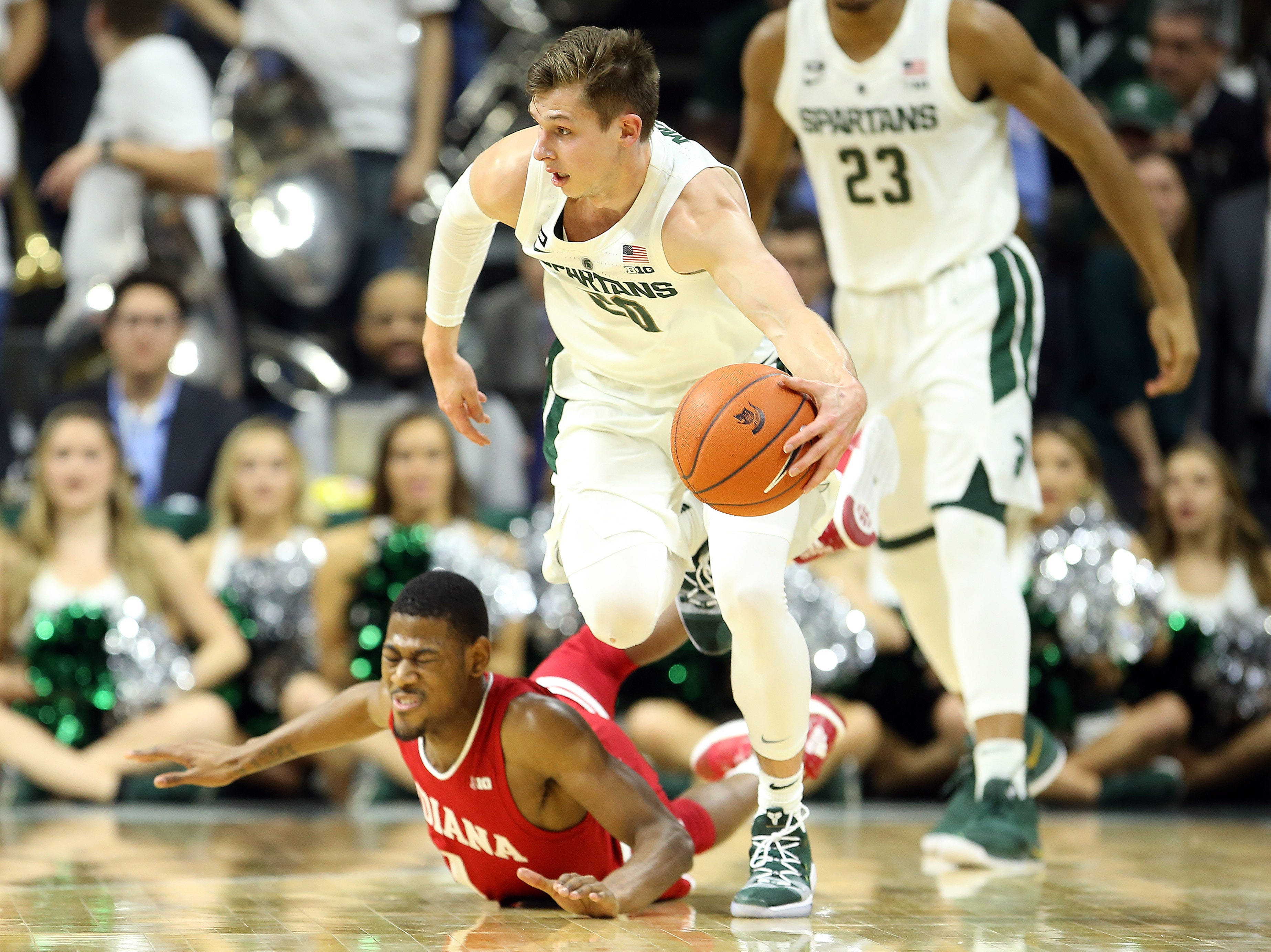 Feb 2, 2019; East Lansing, MI, USA; Michigan State Spartans guard Matt McQuaid (20) steals the ball from Indiana Hoosiers guard Aljami Durham (1) during the first half  at the Breslin Center. Mandatory Credit: Mike Carter-USA TODAY Sports