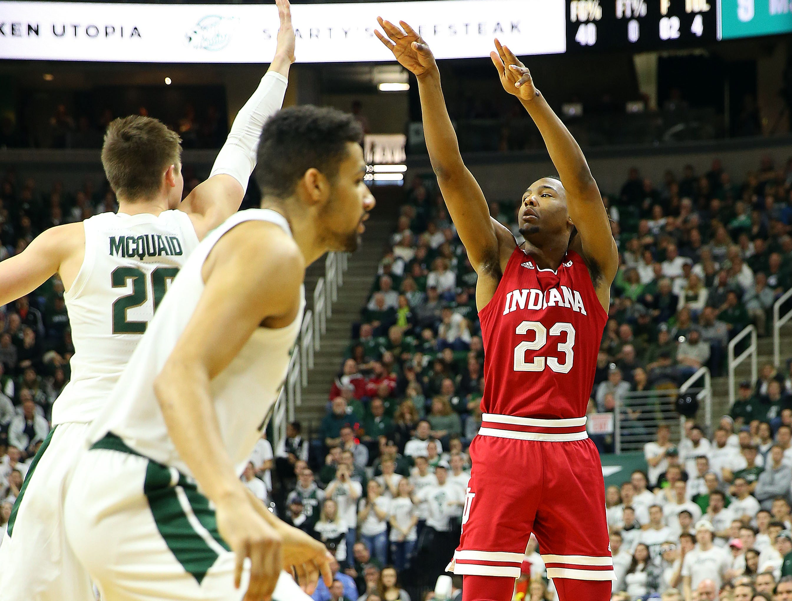 Feb 2, 2019; East Lansing, MI, USA; Indiana Hoosiers forward Damezi Anderson (23) attempts a three point basket over Michigan State Spartans guard Matt McQuaid (20) during the first half  at the Breslin Center. Mandatory Credit: Mike Carter-USA TODAY Sports