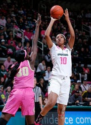 Michigan State's Sidney Cooks, right, shoots against Purdue's Nyagoa Gony (30), Sunday, Feb. 3, 2019, in East Lansing, Mich.