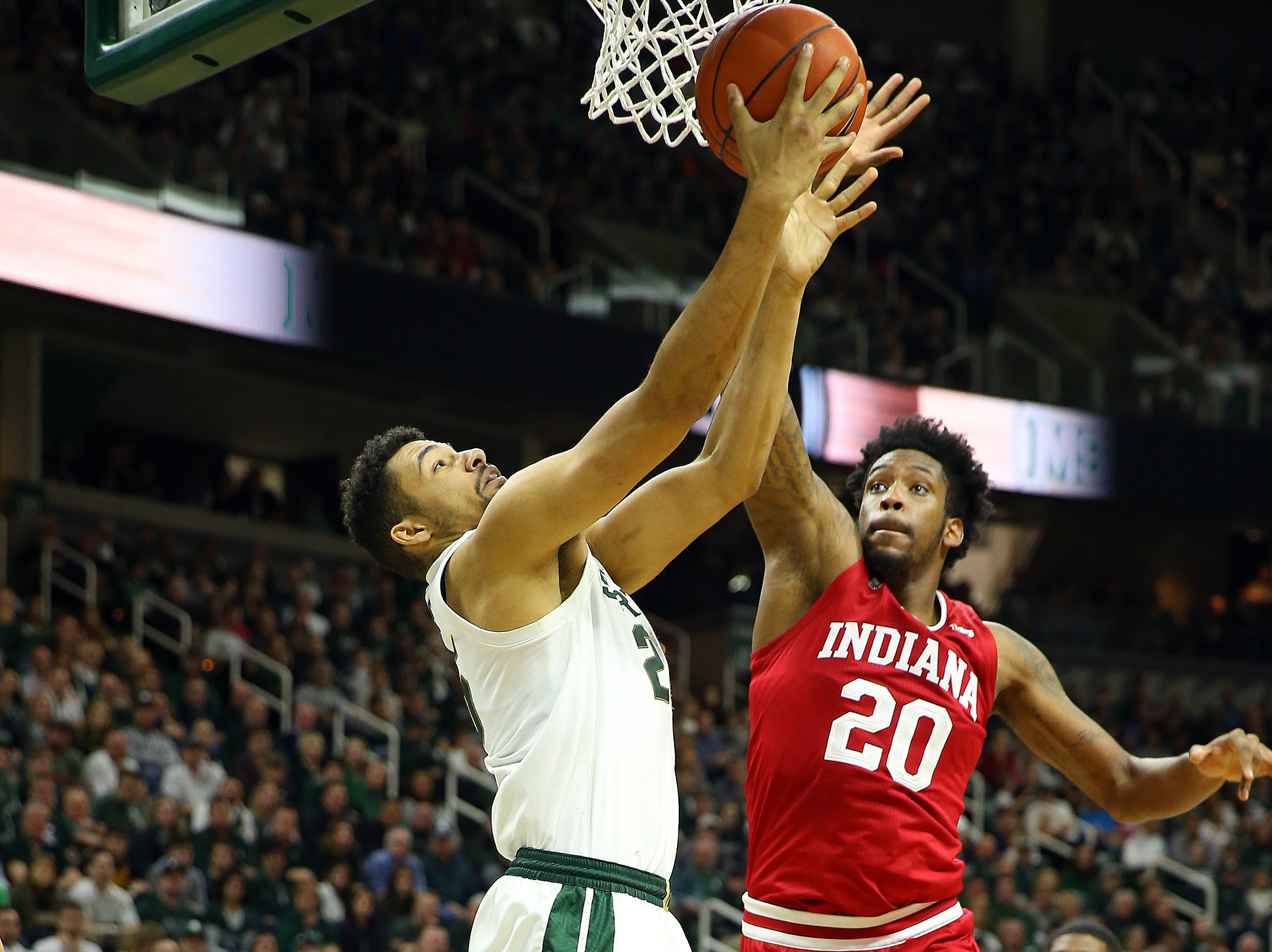 Feb 2, 2019; East Lansing, MI, USA; Michigan State Spartans forward Kenny Goins (25) is defended by Indiana Hoosiers forward De'Ron Davis (20) during the second half of a game at the Breslin Center. Mandatory Credit: Mike Carter-USA TODAY Sports
