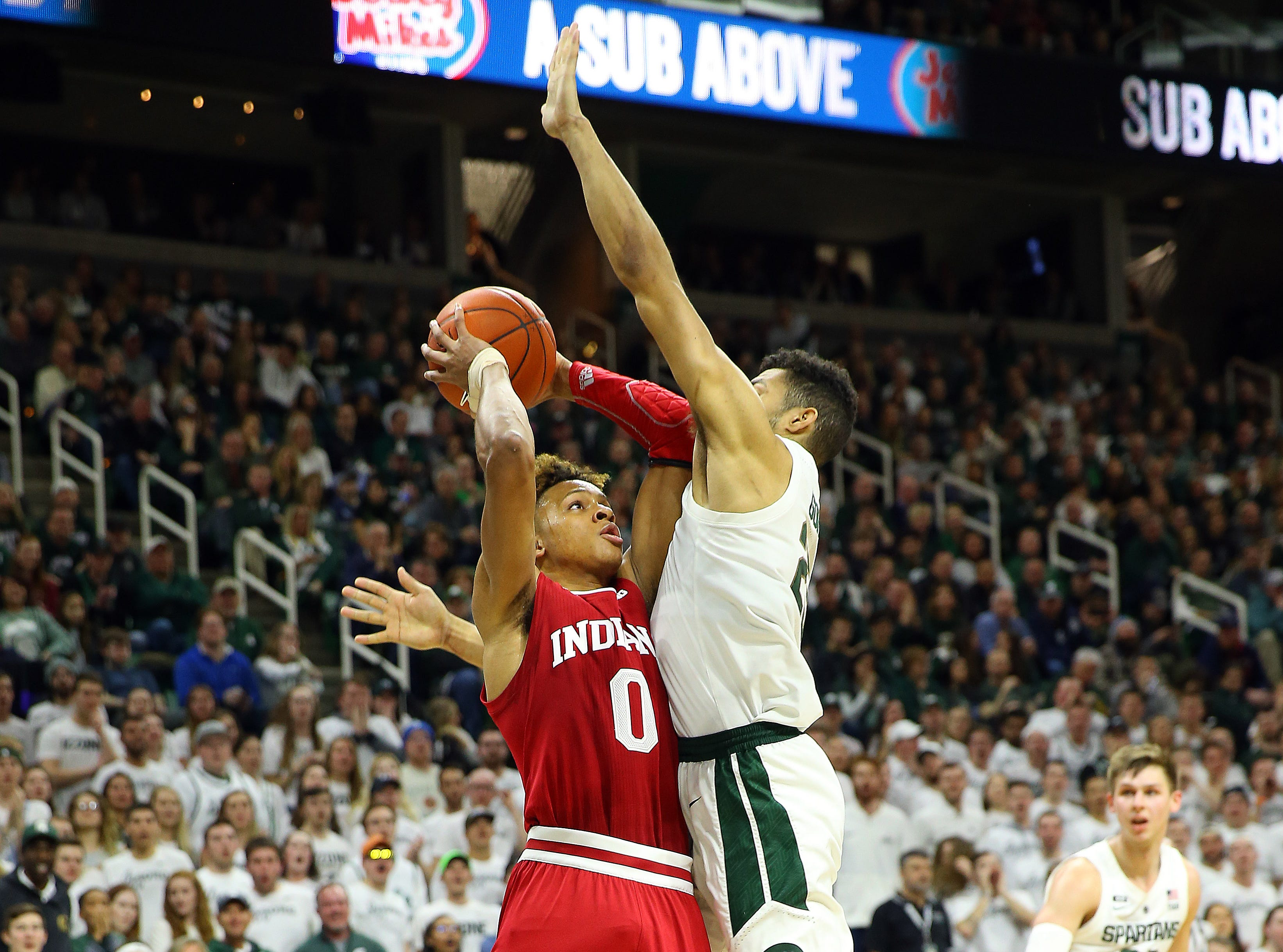 Feb 2, 2019; East Lansing, MI, USA; Indiana Hoosiers forward De'Ron Davis (20) is defended by Michigan State Spartans forward Kenny Goins (25) during the first half  at the Breslin Center. Mandatory Credit: Mike Carter-USA TODAY Sports