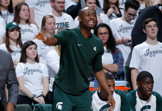 Injured Michigan State junior Joshua Langford shouts instructions to teammates during the Spartans' loss to Indiana on Saturday night. It was the first game since Langford was ruled out for the season with a foot injury.