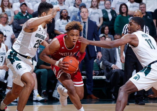 Indiana's Romeo Langford, center, drives between Michigan State's Kenny Goins, left, and Aaron Henry during the first half Saturday in East Lansing.