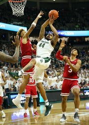 Feb 2, 2019; East Lansing, MI, USA; Michigan State Spartans forward Nick Ward (44) grabs a rebound against Indiana Hoosiers guard Romeo Langford (0) during the second half of a game at the Breslin Center. Mandatory Credit: Mike Carter-USA TODAY Sports