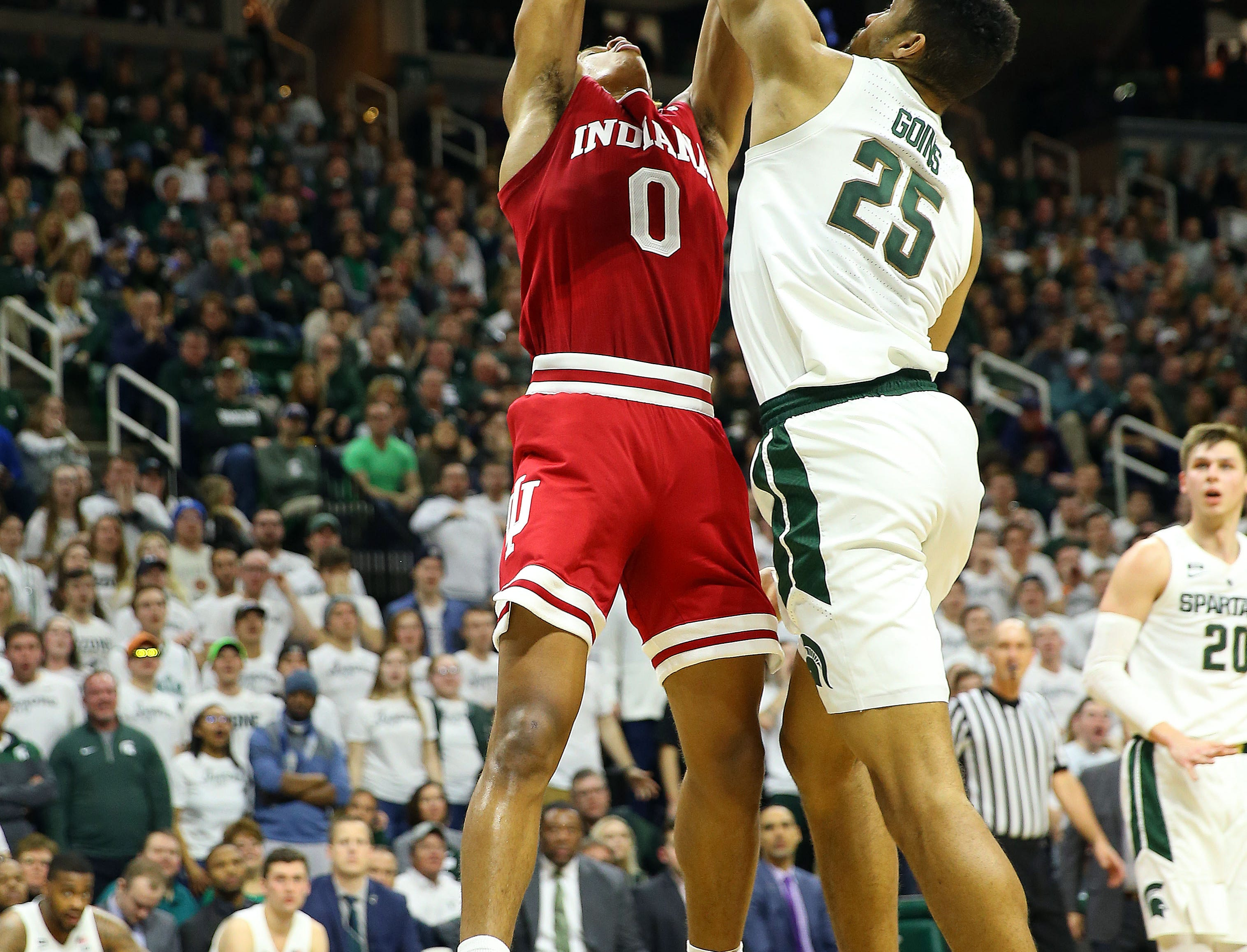Feb 2, 2019; East Lansing, MI, USA; Indiana Hoosiers guard Romeo Langford (0) has his shot blocked by Michigan State Spartans forward Kenny Goins (25) during the first half  at the Breslin Center. Mandatory Credit: Mike Carter-USA TODAY Sports