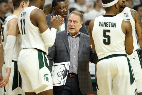 Feb 2, 2019; East Lansing, MI, USA; Michigan State Spartans head coach Tom Izzo talks to Michigan State Spartans forward Aaron Henry (11) during the first half  against the Indiana Hoosiers at the Breslin Center. Mandatory Credit: Mike Carter-USA TODAY Sports