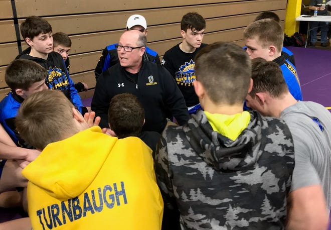 Ontario wrestling coach Kevin Kroll talks with his team during a tournament in 2019. Kroll recently stepped down from the role after nine seasons.