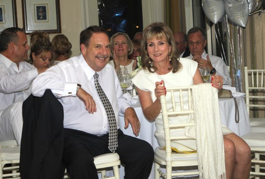 Jim and Allyson Richards enjoy the moment after a successful bid on one of the auction items.