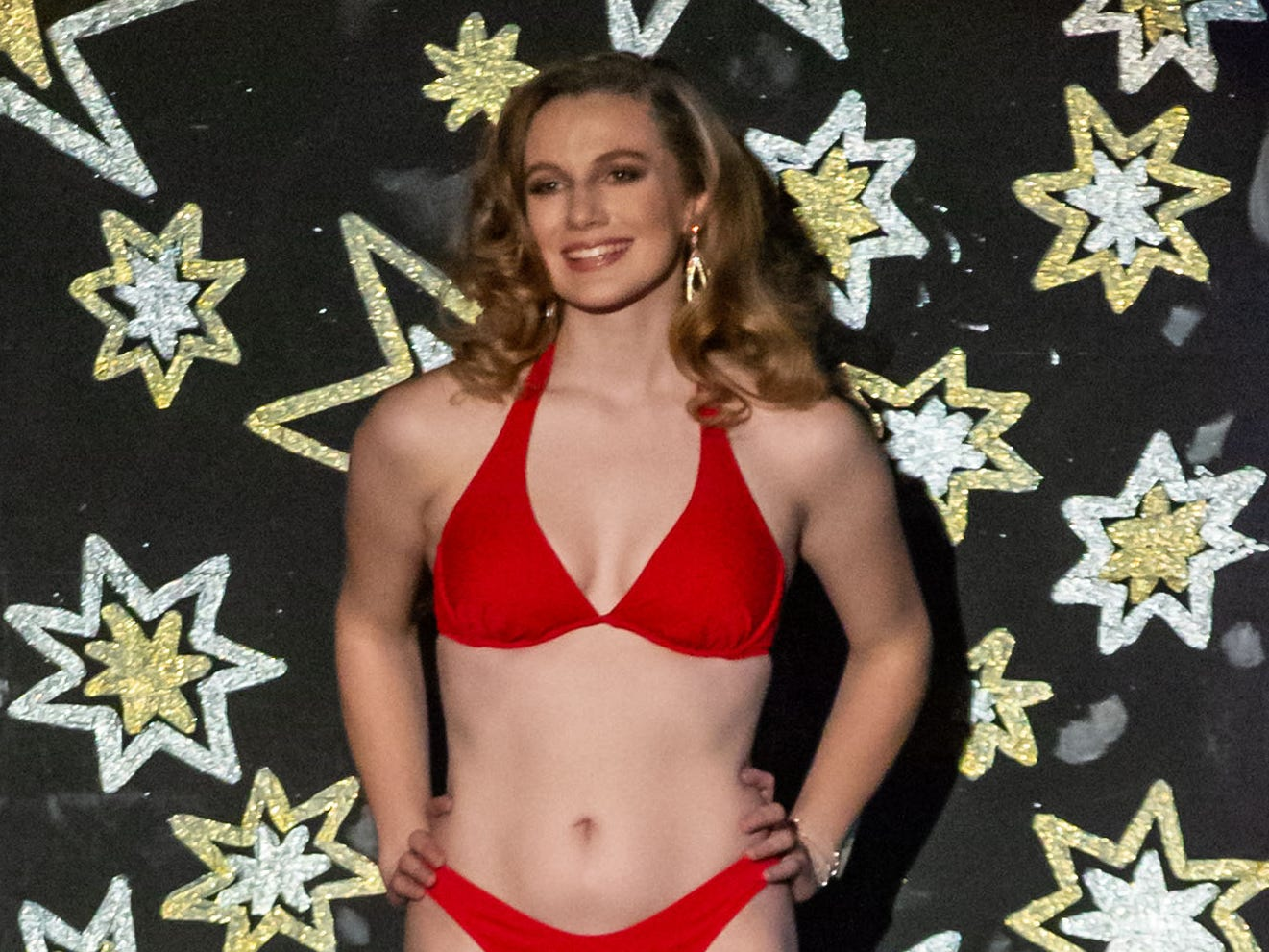 Katelyn Pomianek, sponsored by the St. Francis Lions Club, competes in the swimsuit segment of the 55th annual Miss St. Francis Scholarship Competition at St. Thomas More High School on Saturday, Feb. 2, 2019.