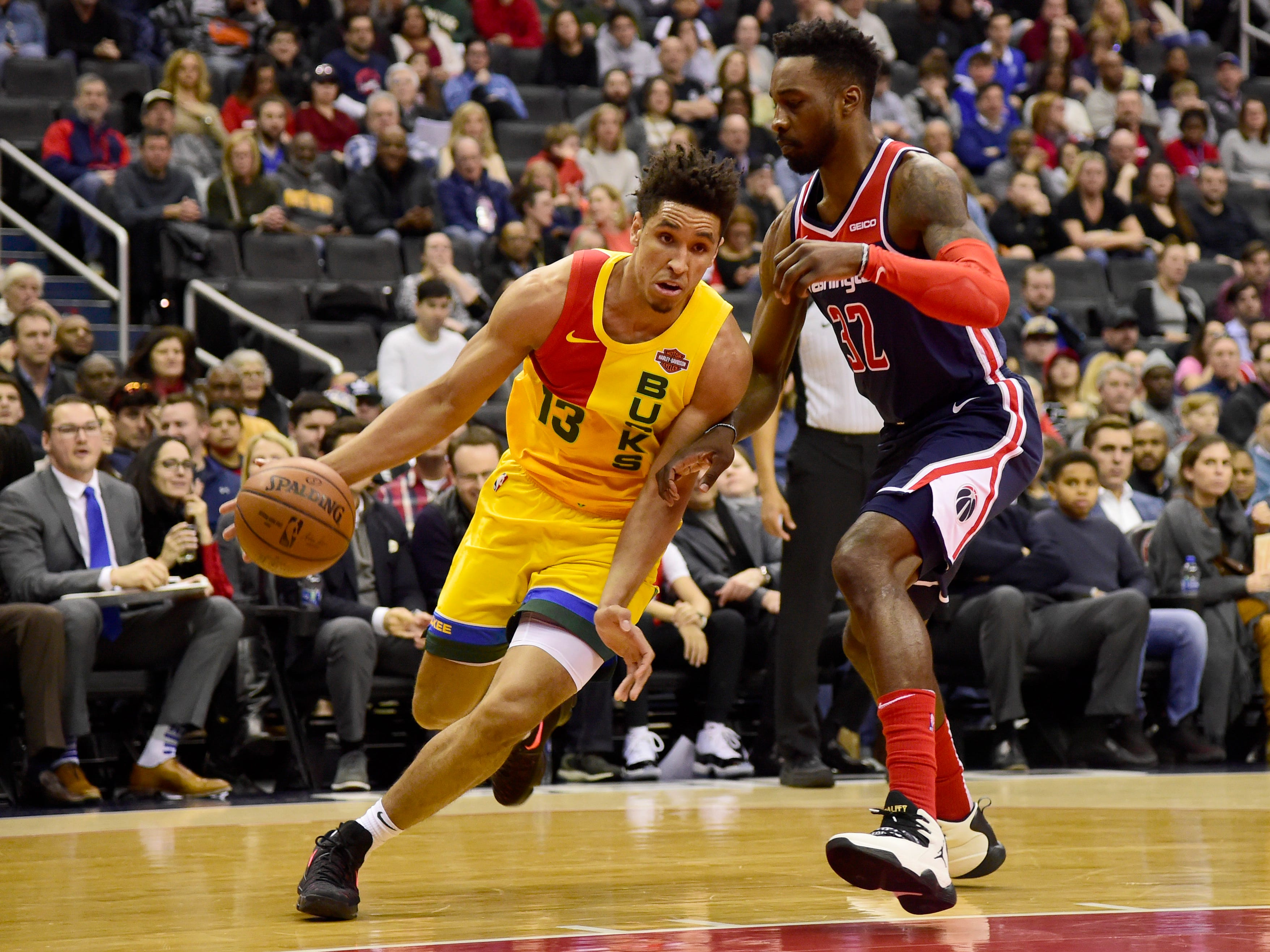 Bucks guard Malcolm Brogdon turns the corner on Wizards forward Jeff Green as he drives to the hoop during the first quarter Saturday night.