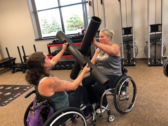 Laura Dwyer (right) works out with Melissa Smith (left) on exercises that strengthen the core.