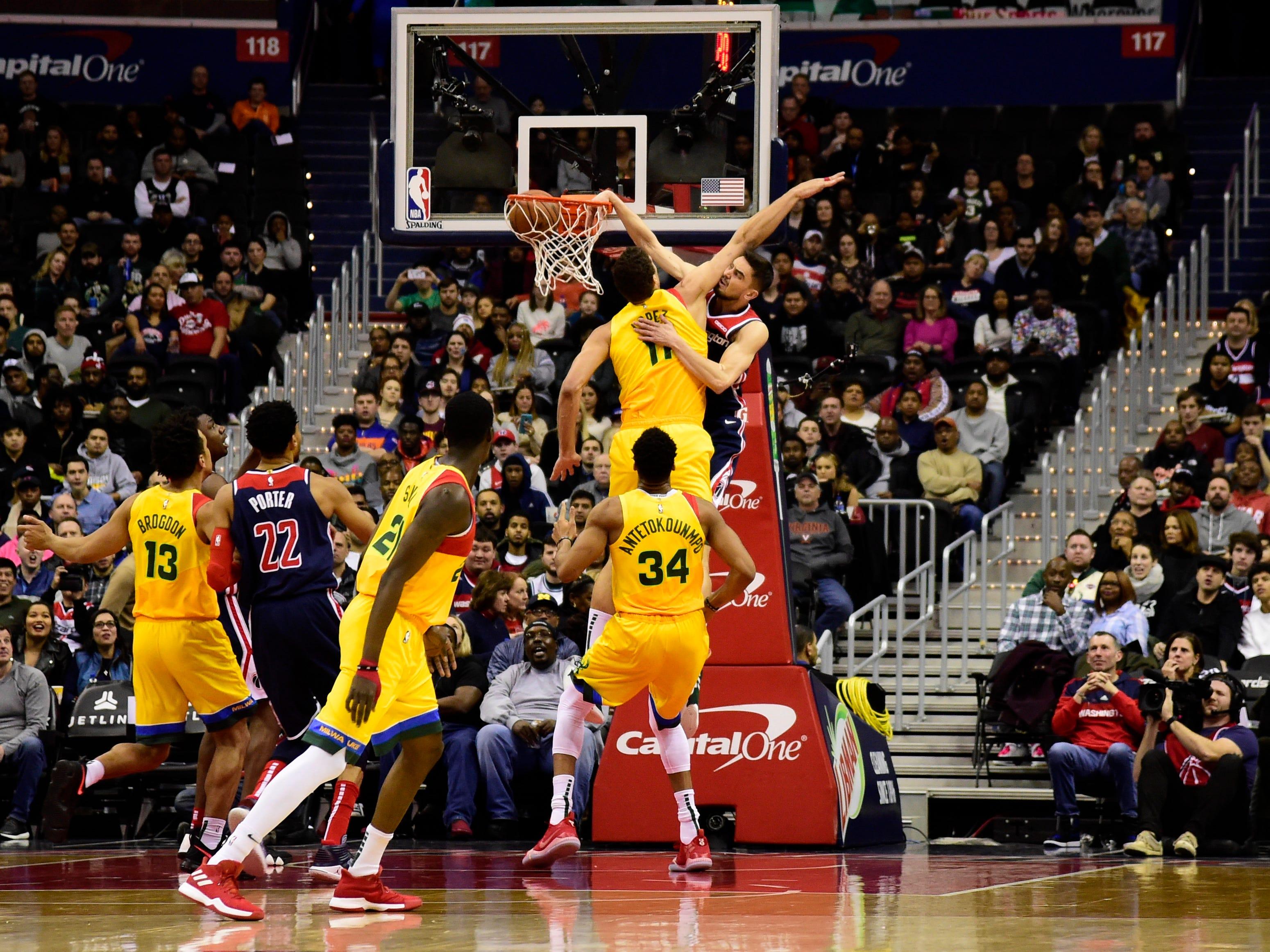 Wizards guard Tomas Satoransky posterizes Bucks center Brook Lopez with a vicious dunk during the first quarter Saturday night.