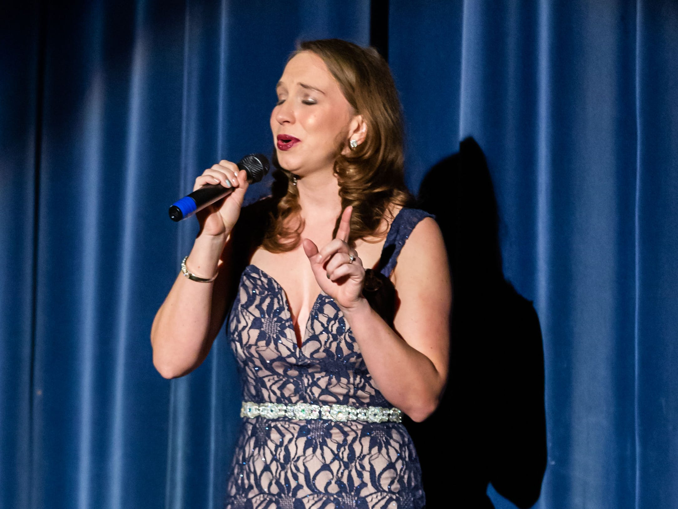 Miss St. Francis 2008, Elyse Wojciechowski-Scheeler, performs a song during the 55th annual Miss St. Francis Scholarship Competition at St. Thomas More High School on Saturday, Feb. 2, 2019.