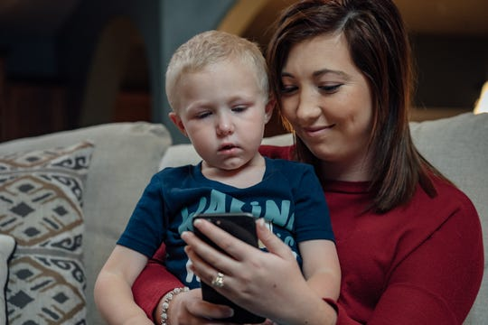 A mother and her son utilize Baxter Regional CARE, a new telemedicine service that provides urgent care to users 24 hours a day, seven days a week, 365 days a year.